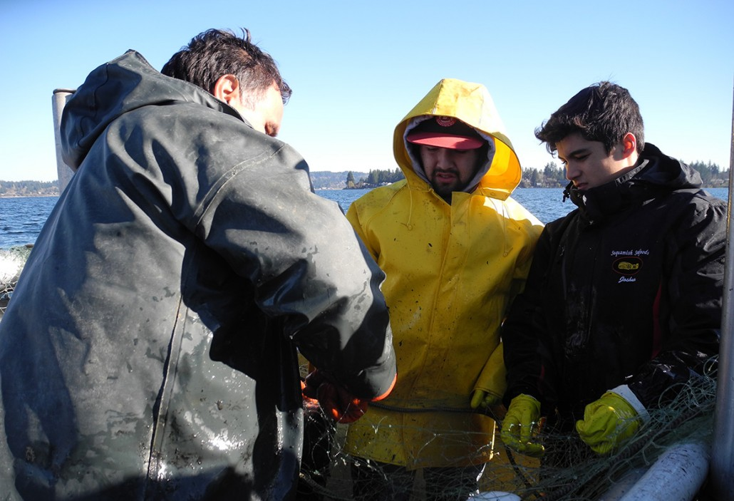 Suquamish Fisheries Director Rob Purser shows Chief Kitsap Academy Students how to maintain salmon fishing nets.
